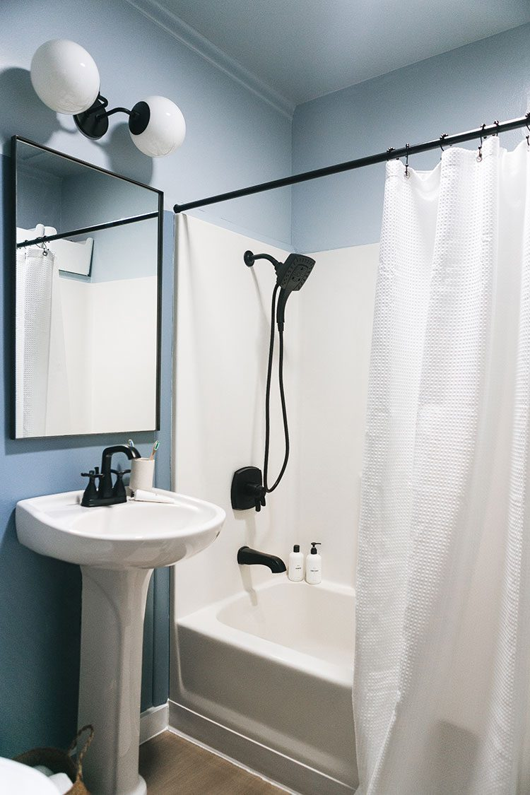 How to Refresh a Tiny Bathroom with the Delta Faucet brand + Learn all about H2Okinetic®  Technology. #deltafaucet #ad #bathroommakeover #shower #showerfixture #showerhead #minimakeover #bathroomrefresh #tinybathroom #smallbathroom