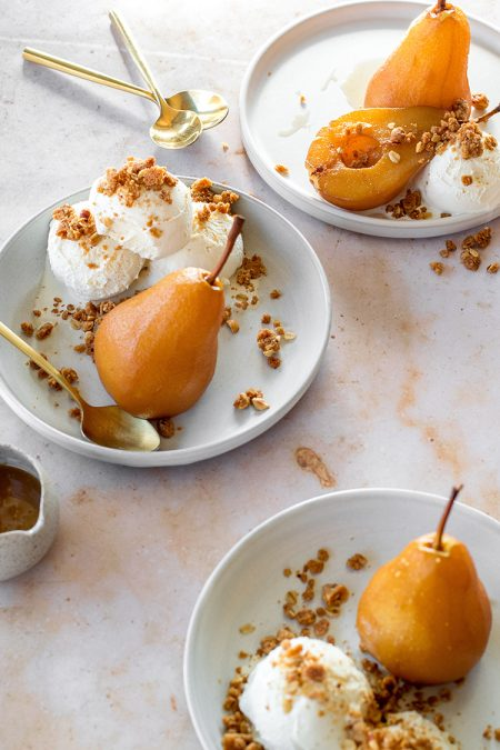 Chai-Poached Pears with Spiced Hazelnut Oat Crumble and Caramel Sauce Recipe. Delicious and shockingly easy dessert recipe for fall, Thanksgiving, or holiday parties! #pears #poachedpears #fall #autumn #thanksgiving #dessert #caramelsauce #chai #chaispiced #oatcrumble #hazelnuts