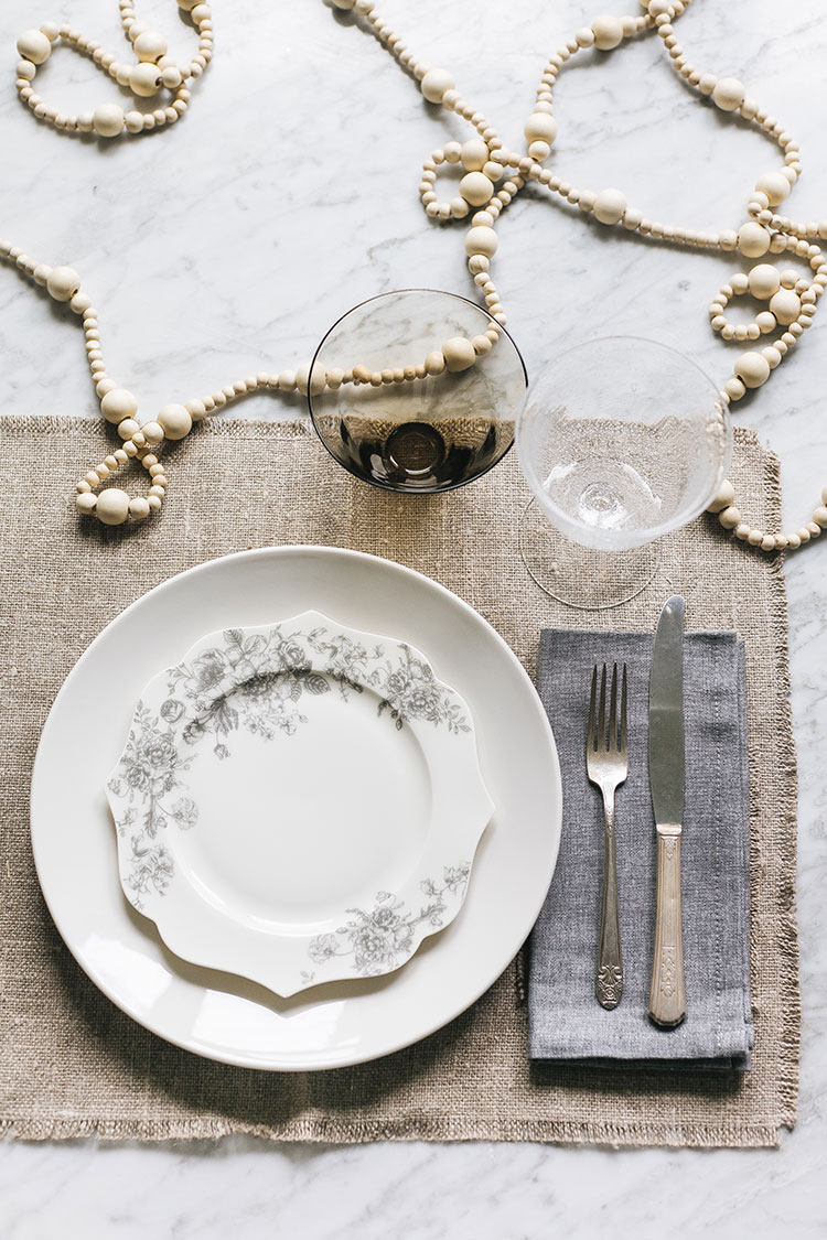 Dress Up Your White Dinnerware For the Holidays With One of These Looks! Entertaining and tablescape styling tips for Thanksgiving, Fall, Holidays, Christmas, New Years, and Hanukkah via jojotastic.com #tablescape #styling #tabletop #entertaining #holidays #dinnerware #whitedinnerware