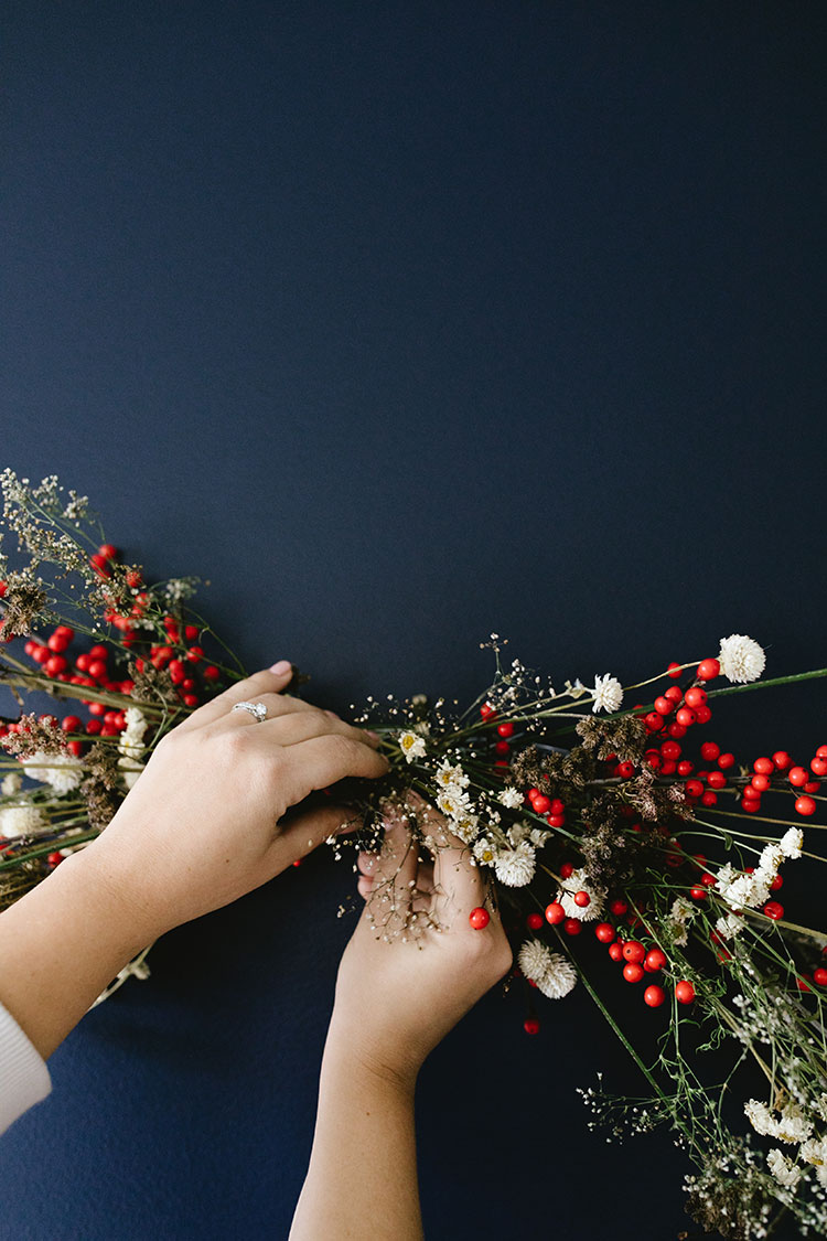 Ditch the Wreath & DIY This Modern Bough Instead! Learn how to make a Christmas bough, perfect for holiday decor. #bough #diy #christmas #christmasDIY #DIYtutorial #floralarrangement #florals #driedflowers #branches #modernchristmas #christmasdecor
