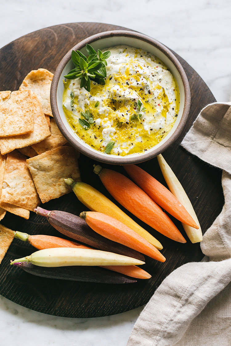 The Easiest Last-Minute Appetizer Recipe, Whipped Feta with pita chips and vegetable crudite for an easy dish to bring to a holiday party. Easy appetizer with Greek flavor. #greekfood #feta #appetizer #easyrecipe #recipe #easyappetizer