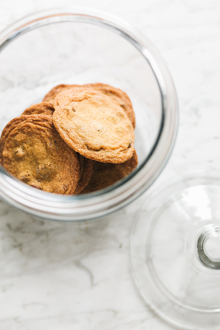 Chewy Chocolate Chip Cookies with Sea Salt Recipe. The best chocolate chip cookie recipe for the annual Blog Hop Cookie Swap! For even more holiday cookie recipes, be sure to check out everyone else participating on jojotastic.com! #christmascookies #cookieswap #cookierecipe #chocolatechipcookies #chocolatecookies #cookies #seasalt