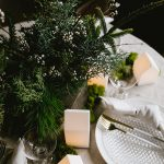 How to Style a Festive Forest Christmas Tablescape! Inspired by Nordic and Scandinavian decor and hygge holiday decorations. Entertaining tips for small spaces for the holidays. #christmastable #tablescape #holidaytable #christmasdecor #holidaydecor #greendiningtable #diningtable #christmasvillage #hygge