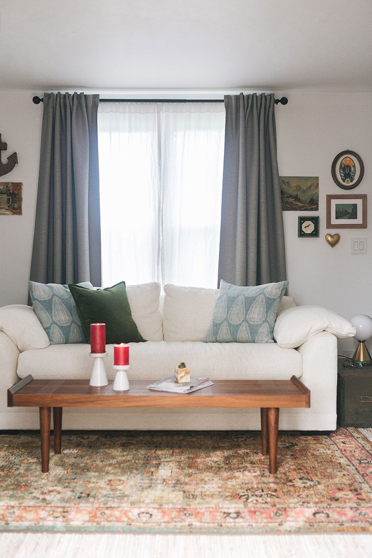 The Full List of Sources for Our Living Room Makeover: including furniture, lighting, textiles, rugs, decorative accents, paint color, curtains & more! Get all of the details of our small space living room on jojotastic.com  #smallspaces #livingroom #smalllivingroom #tinyhouse #livingroommakeover