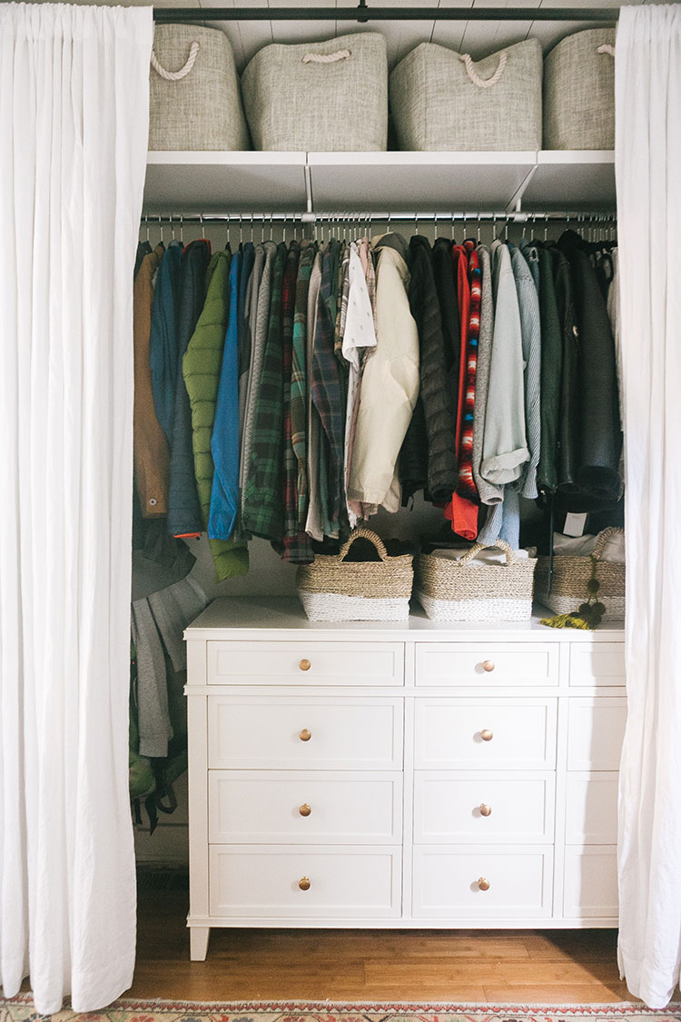Check Out Our Closet Tour + Learn How to Organize a Small Closet with GetClairefied (VIDEO)! small space storage using elfa shelving from the container store, @potterybarn dresser, @barnandwillow custom curtains. get the details and full source list on jojotastic.com #smallspaces #closet #closetorganization #storageideas #closetideas #elfacloset #smallcloset