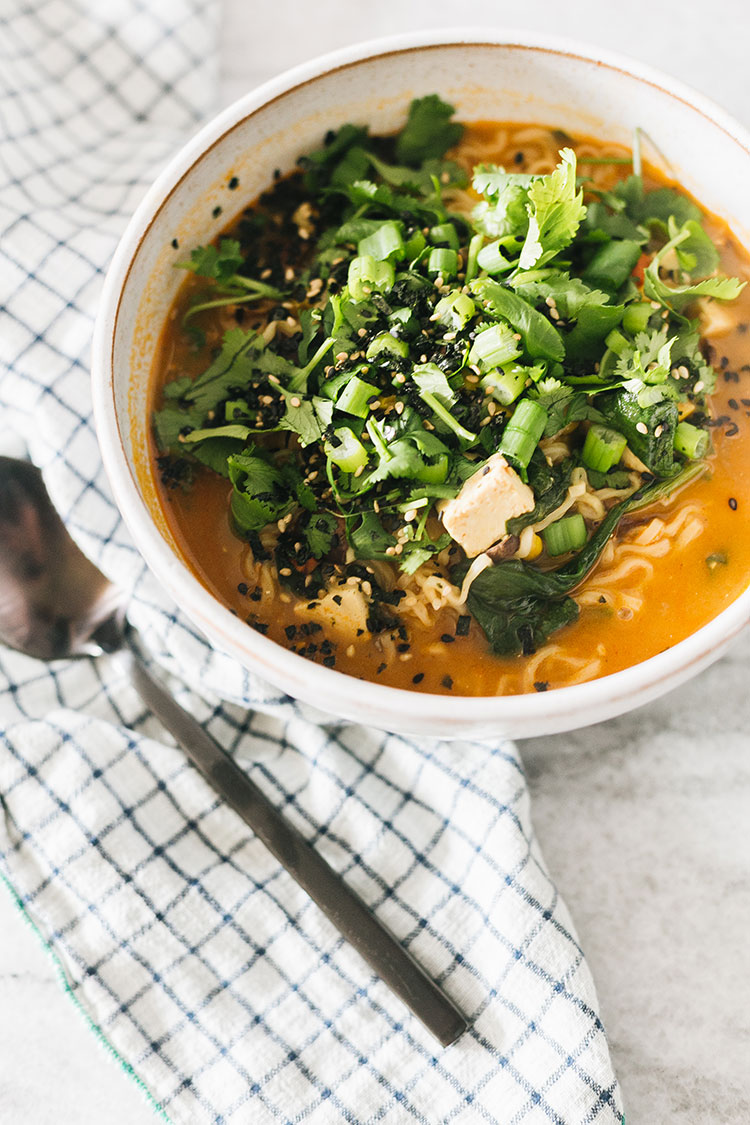 How to Make My Easy Ramen Recipe with Pantry Staples! Brothy noodles with ginger, cilantro, tofu, sesame oil, gochujang and more. An easy lunch or cheap dinner idea. #recipe #ramen #ramenrecipe #pantry #pantrystaples #pantryessentials