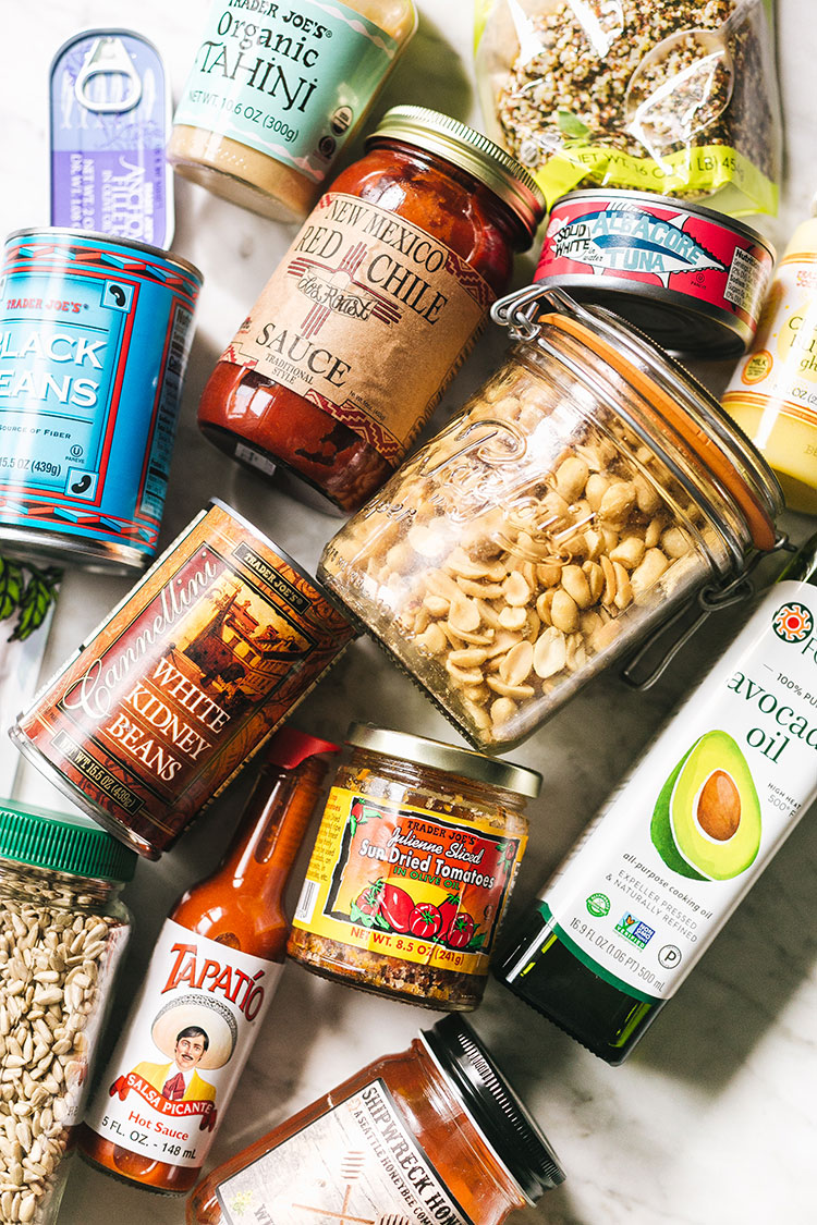 My (Long) List of Pantry Staples That I Always Keep Stocked + How I Use Them! All of the pantry essentials including pasta, canned goods, jarred foods, preserved foods, dry goods, sauces, condiments, oils and vinegars, proteins, rice, dairy essentials and MORE that I keep on hand for meals every day. #pantryessentials #pantrystaples #pantry #grocerylist #groceryshopping