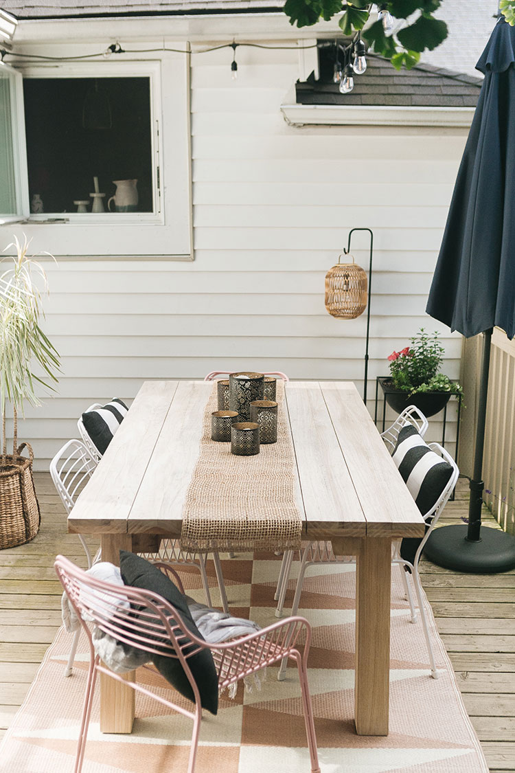 Tour Our Updated Outdoor Dining Space with furniture from Article, my favorite source for affordable, stylish, modern outdoor furniture! #AD Get the details of our teak dining table, powdercoated metal chairs, navy blue umbrella, outdoor lanterns, terrazzo planter and more! Before and after of our small deck for small space living #smallspace #outdoordecor #outdoordining #outdoorentertaining #deck #patio