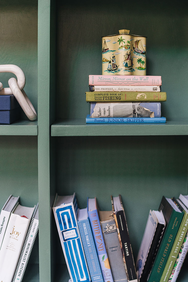 Tour Our Built-Ins & Learn How to Style Built-In Shelving. Styling and decor tips from a pro, how to style a shelves and curate books and vintage decor. Green built in bookshelves