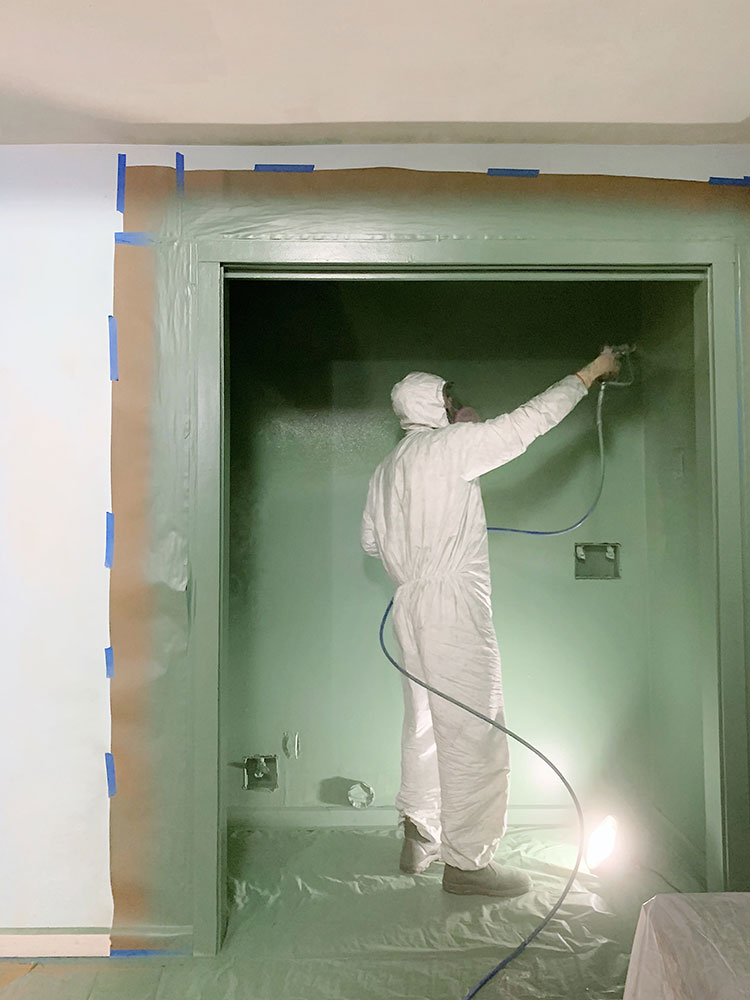 Our Ultimate Guide to Interior Painting with a Sprayer! How to use a paint sprayer, why it's better than rolling and using a brush, the paint spraying tools and equipment we used, how to prepare to spray paint and more!