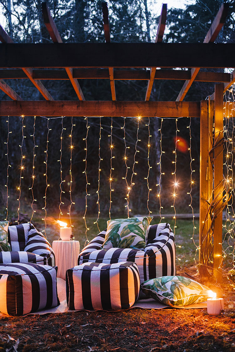 Easy date night idea: create a tropical oasis in your backyard on a budget with @bhglivebetter @walmart with stylish and affordable outdoor furniture, weather resistant pillows, twinkly lights, bug repellent torches and more. Shop the post & learn more on jojotastic.com #BHGlivebetter #walmart #betterhomesandgardens #AD