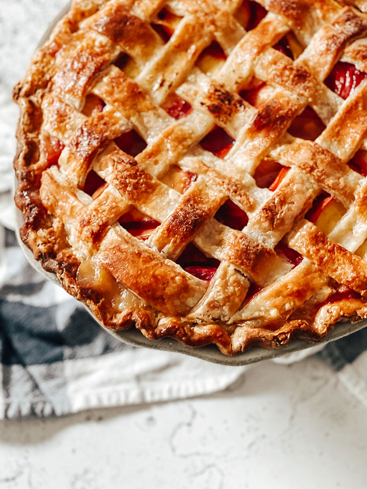The Best Homemade Peach Pie Recipe (With Thyme & Honey), perfect dessert for Fourth of July, summer, and stone fruit season. How to make the best lattice pie crust from scratch and the best peach pie filling from scratch