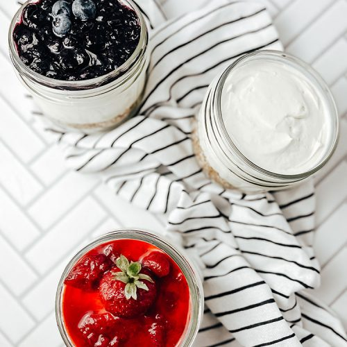 Quick and easy no-bake cheesecake recipe with seasonal summer fruit, made with the easiest cheesecake crust from pretzels! The perfect summer dessert for a bbq or picnic in cute mini mason jars