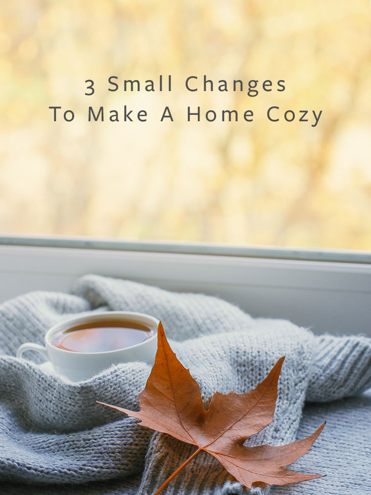 3 Small Changes To Make A Home Cozy for fall including how to create ambient lighting and a warm glow, embracing hygge style with textiles and textures, and the best fall candles