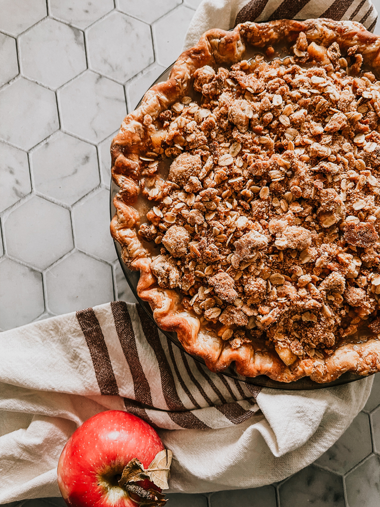 Cinnamon Sugar Spiced Crumble Apple Pie Recipe. How to make a traditional apple pie with homemade crust and a Spiced Cider Filling. how to blind bake, should I pre-cook apples for pie, apple pie crumble topping.