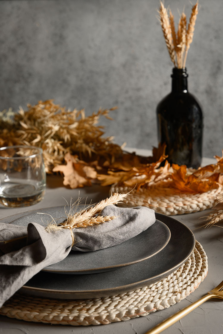 Affordable fall home decor finds, all under $100 including pumpkin candles, candle holders, cozy pillows, plaid throws, fall wreaths, autumn serving platters and more!